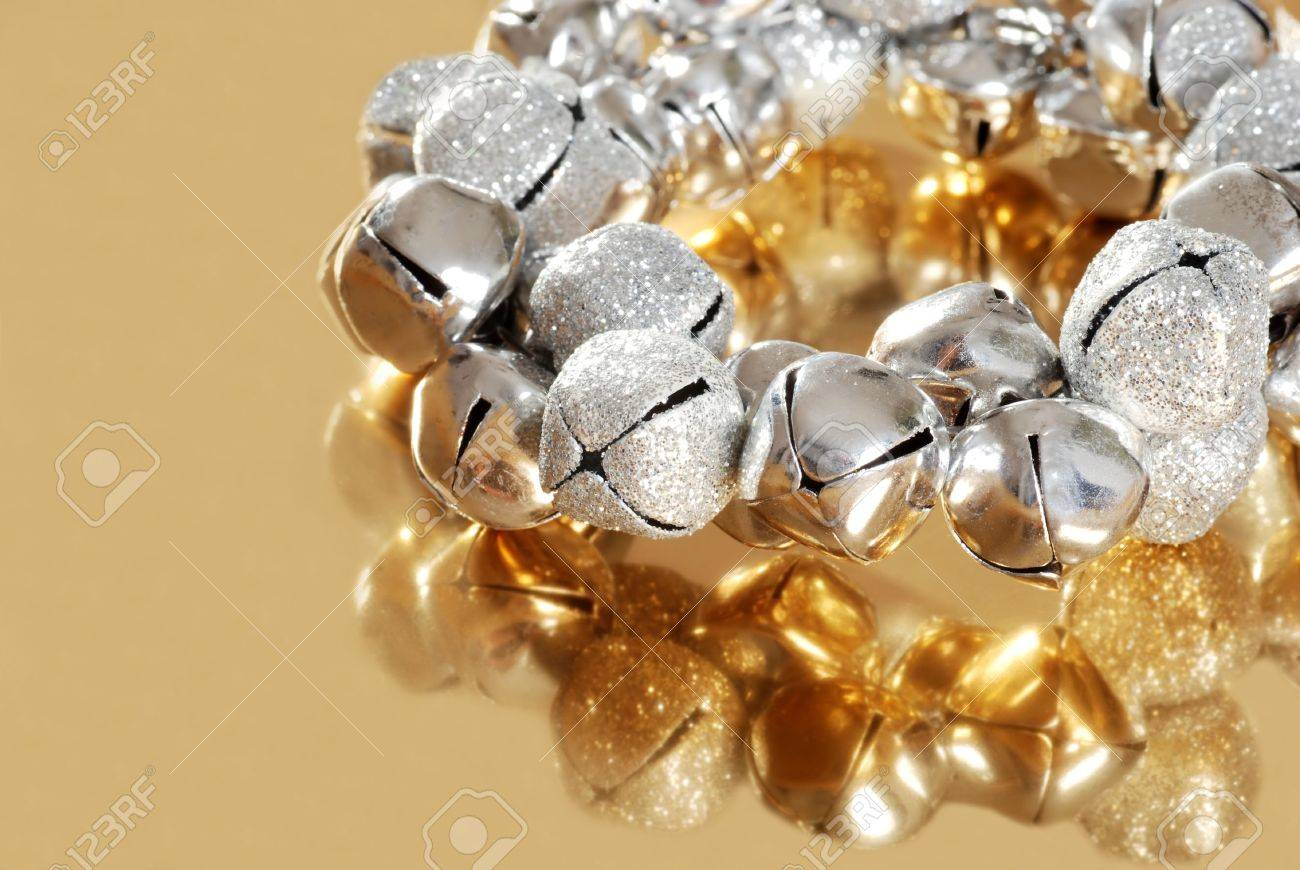 silver jingle bells with gold reflection Stock Photo - 8337701