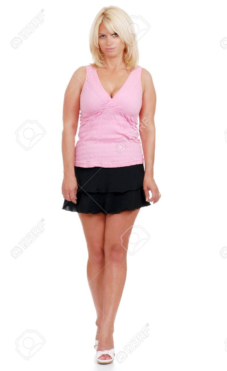 Mature Woman Wearing Short Skirt And Pink Top Stock Photo, Picture ...