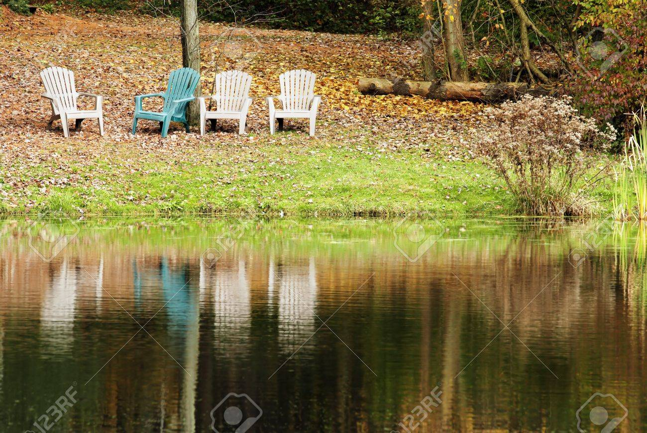 four chairs by the lake Stock Photo - 11118144