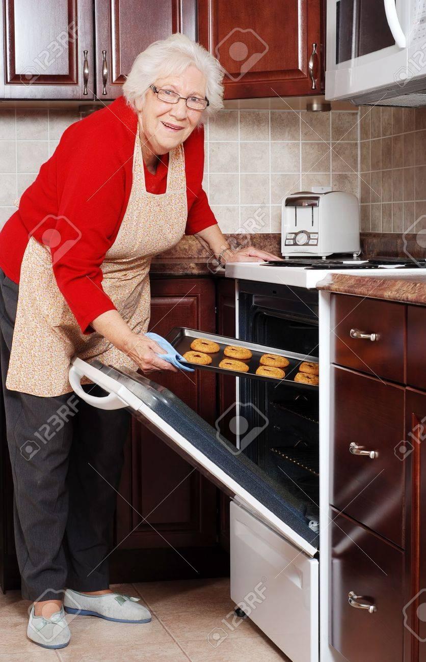 senior woman baking cookies Stock Photo - 11276863