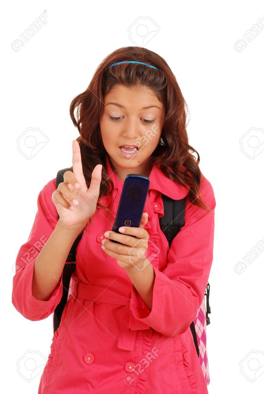 Girl with attitude texting on cell phone Stock Photo - 14428409