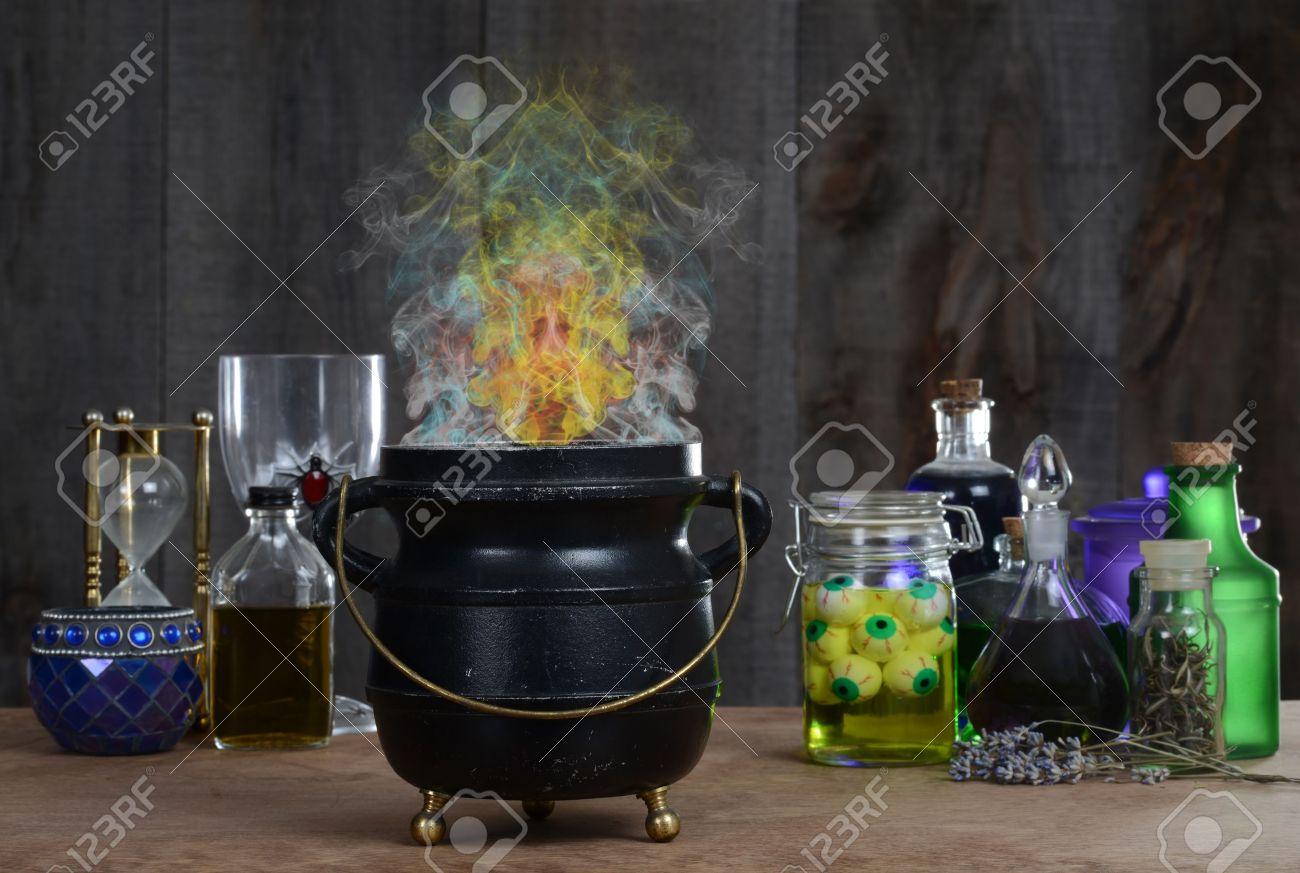 Witch cauldron with smoke - 14891146