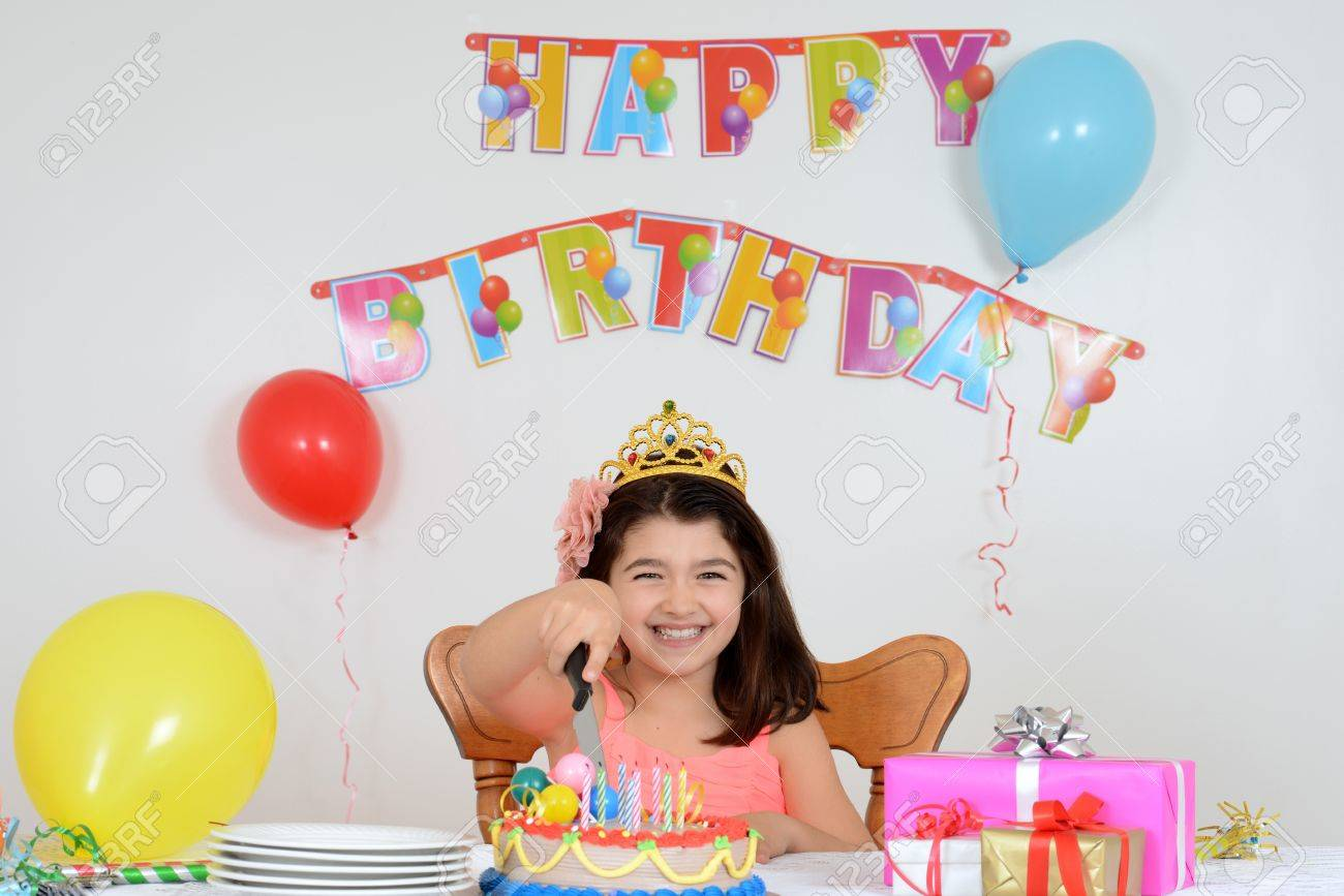 Happy Child Cutting Birthday Cake Stock Photo