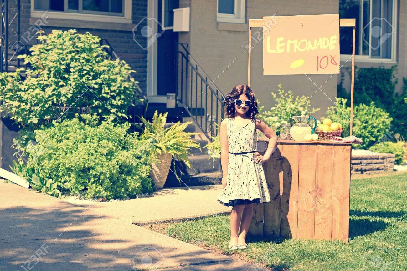 retro girl wearing sunglasses with lemonade stand - 20470125