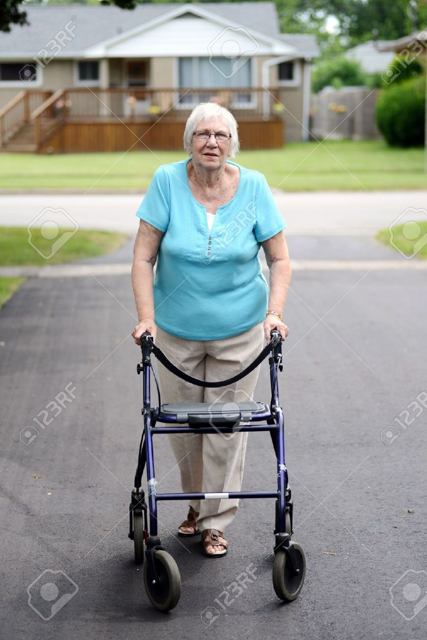 senior woman with walker - 21466584