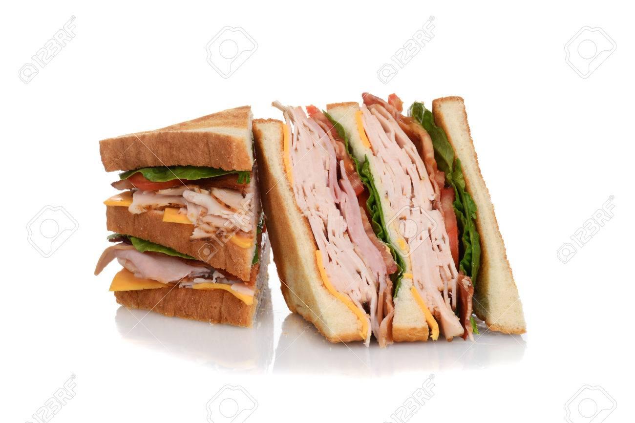sliced chicken club sandwich - 53442330