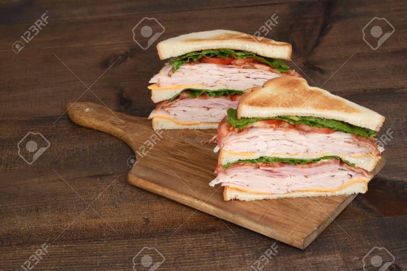 toasted chicken club sandwich - 54274225