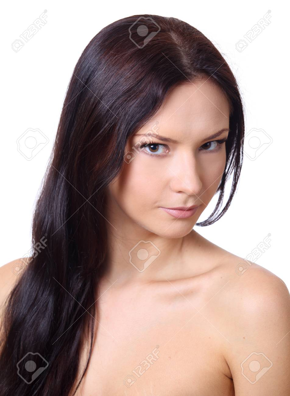 Beautiful brunette twenty years' girl. Close-up portrait. Isolated on white. Stock Photo - 19943727