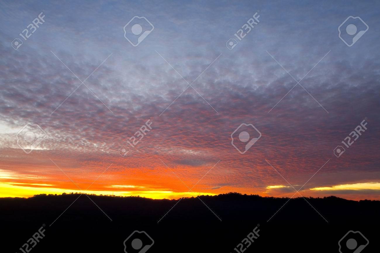 Yellow, orange, pink, purple, and blue sunset over a mountain range (1861) Stock Photo - 1527308
