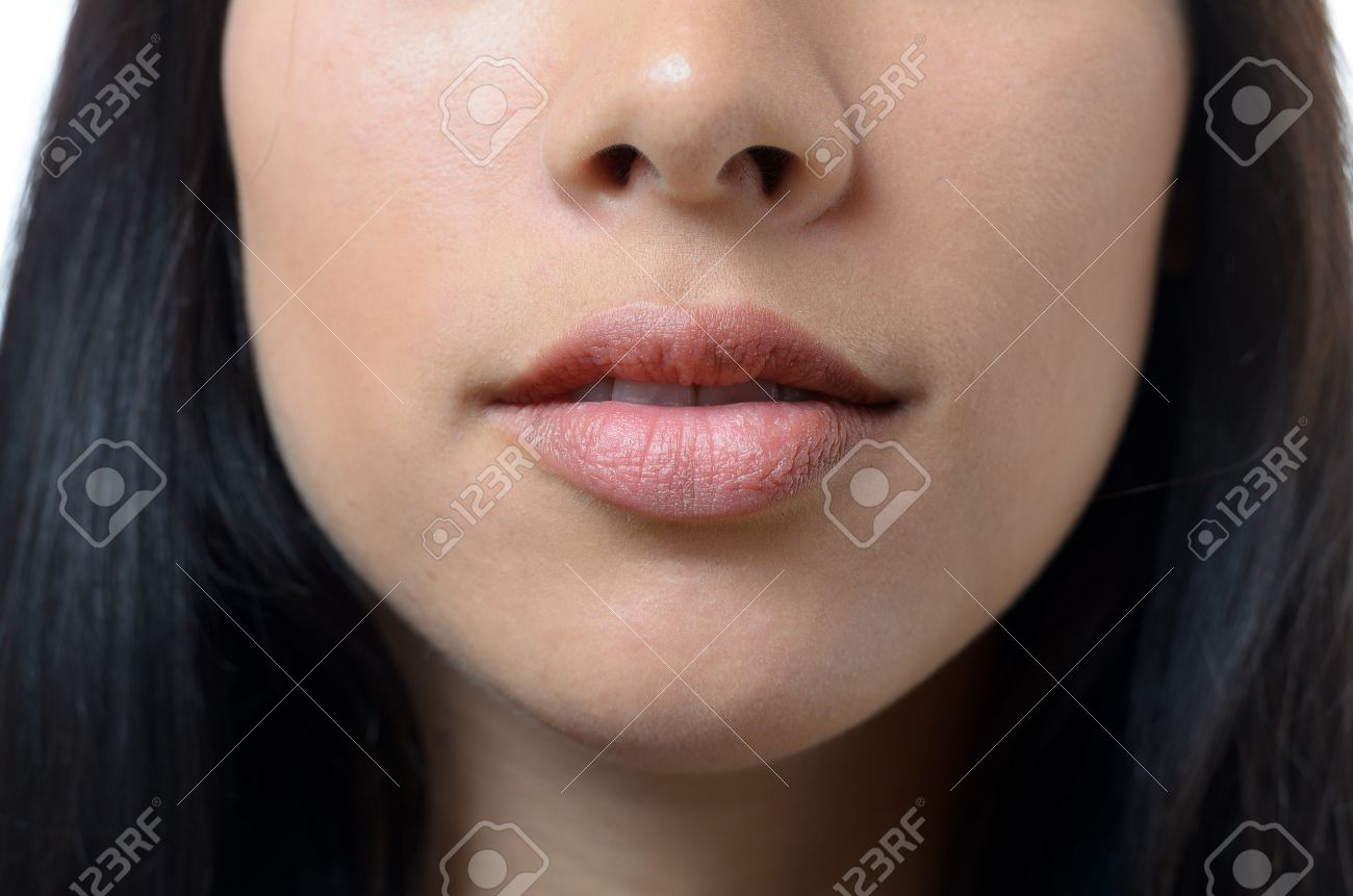 Natural Lips And Mouth Of A Young Woman With No Makeup And Long