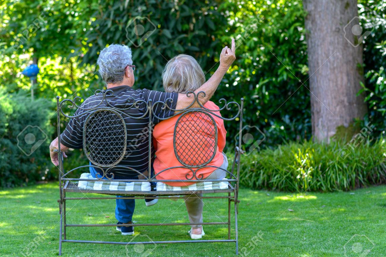 Heavy Duty Counter Stools, Senior Couple Sitting On A Wrought Iron Garden Bench In The Shade Stock Photo Picture And Royalty Free Image Image 83043458