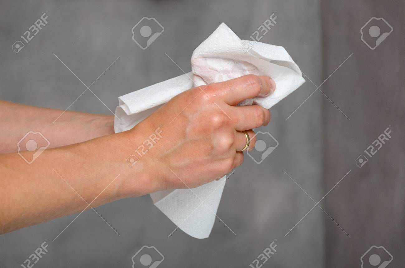 Close up view of female hands holding white towel - 111674713