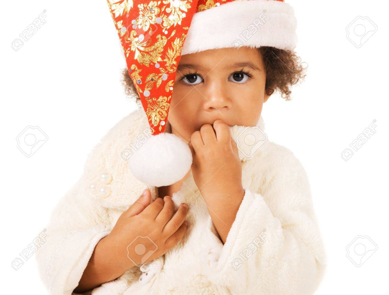 3afac0c63 Portrait of a cute baby in Christmas hat and fur on white background