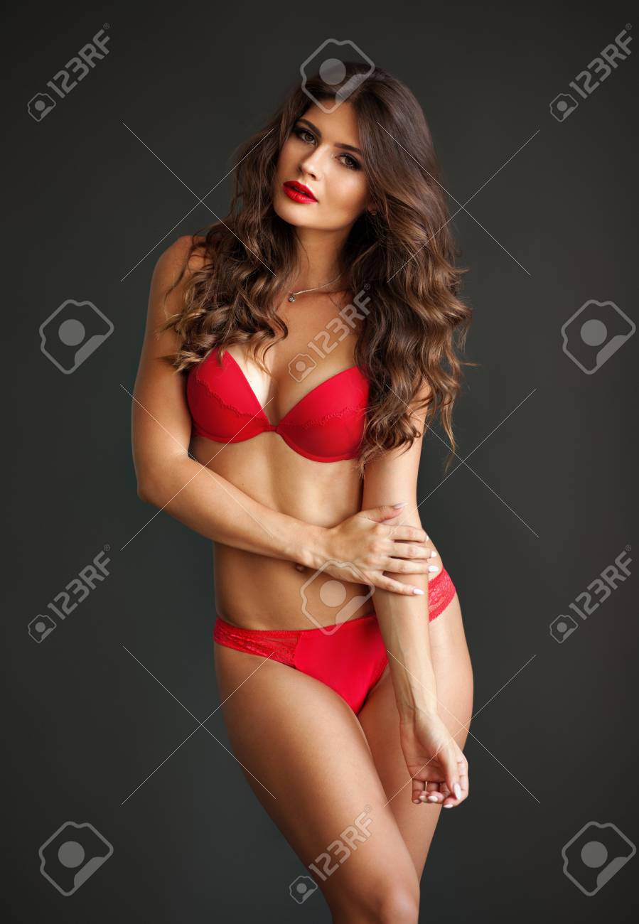 cbe83758d Pretty elegant lady in beautiful red lingerie against dark gray background  Stock Photo - 94812969