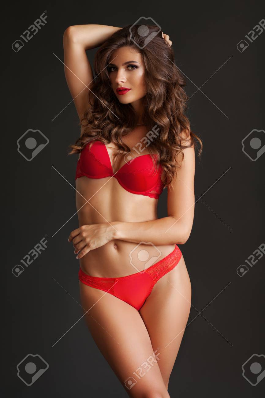 c47a1a5324090 Pretty elegant lady in beautiful red lingerie against dark gray background  Stock Photo - 94681498