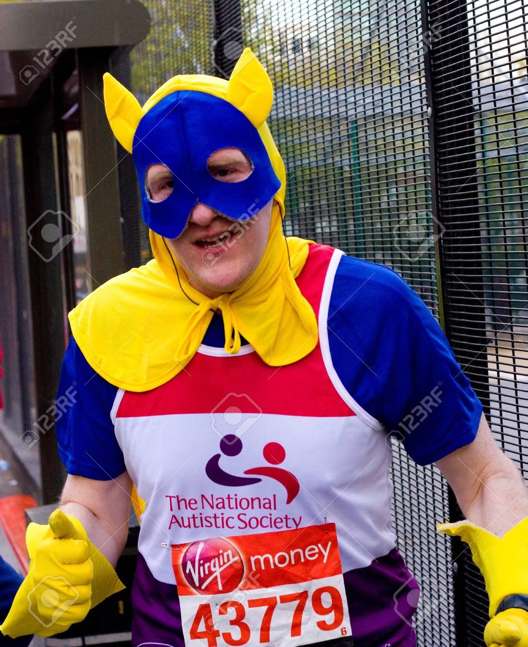 LONDON - APRIL 22: Unidentified man runs the London marathon on April 22, 2012 in London, England, UK. The marathon is an annual event. Stock Photo - 13316019