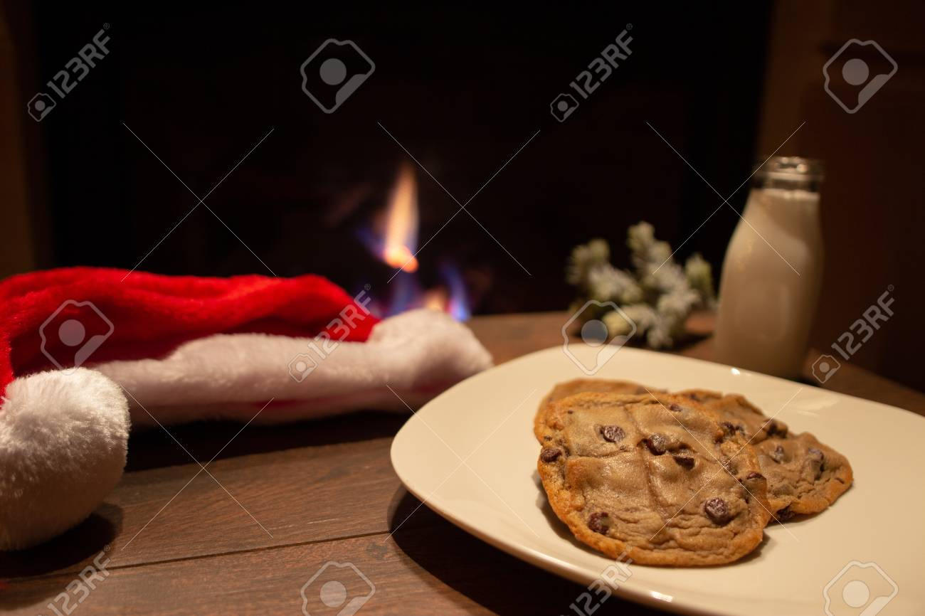 Cookies And Milk Waiting For Santa Claus By The Fireplace On