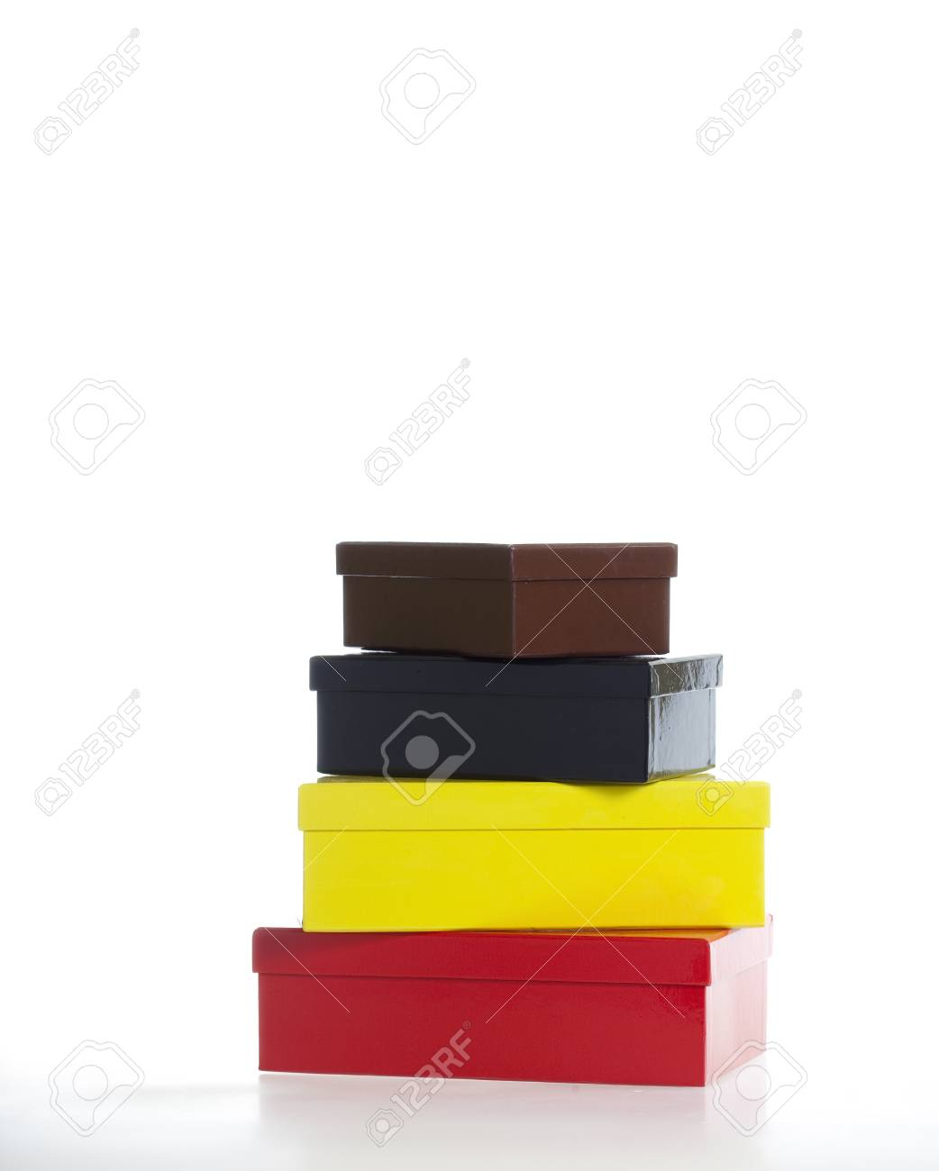 Four multi-colored boxes isolated on white - part of a series of images with eight boxes stacked upon each other sequentially. Stock Photo - 17655736