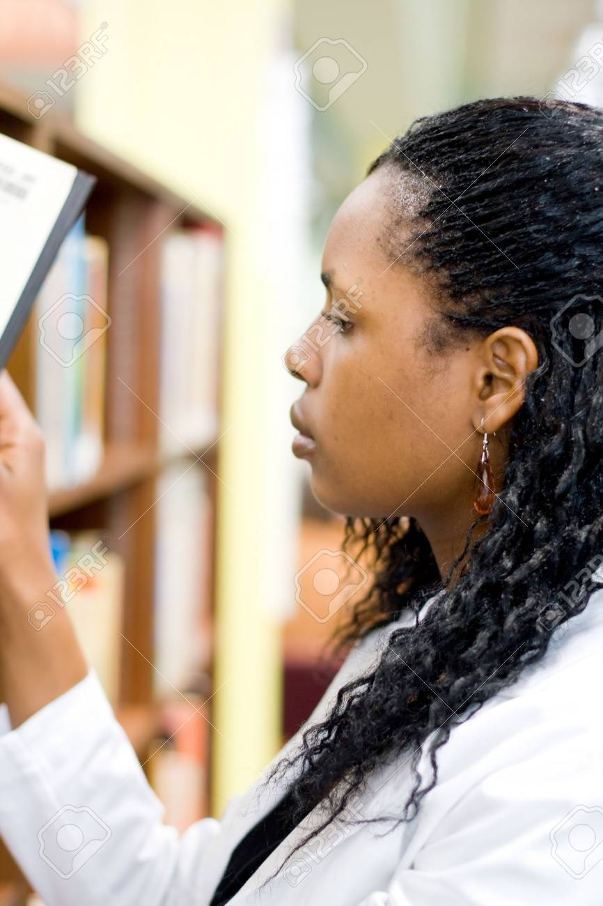 young african student in library Stock Photo - 3922895