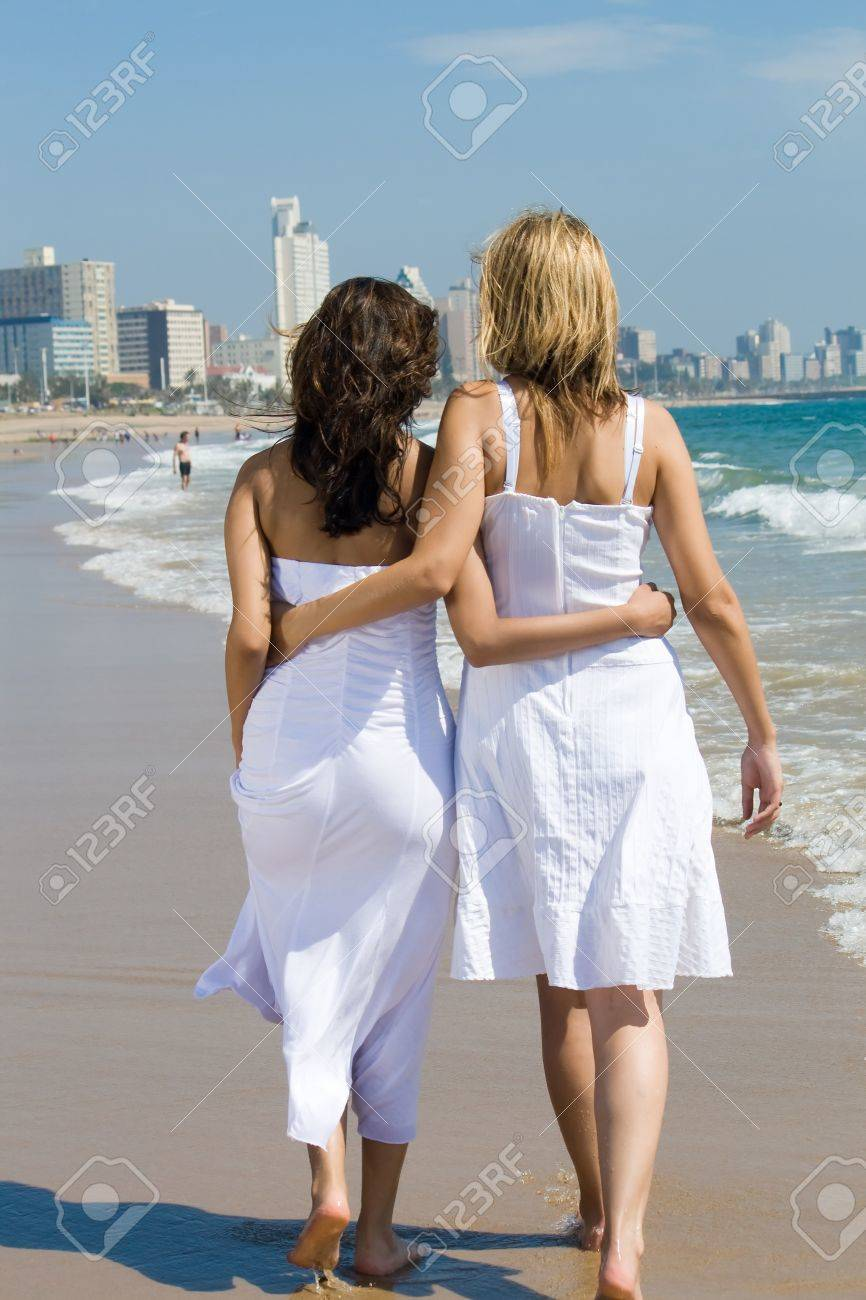 Woman walking on a beach royalty - Two Women Friends Walking On Beach Stock Photo 3944193