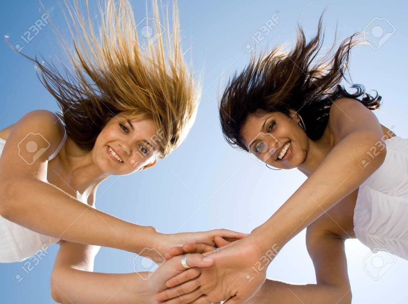 two young women friends having fun on beach Stock Photo - 3944042