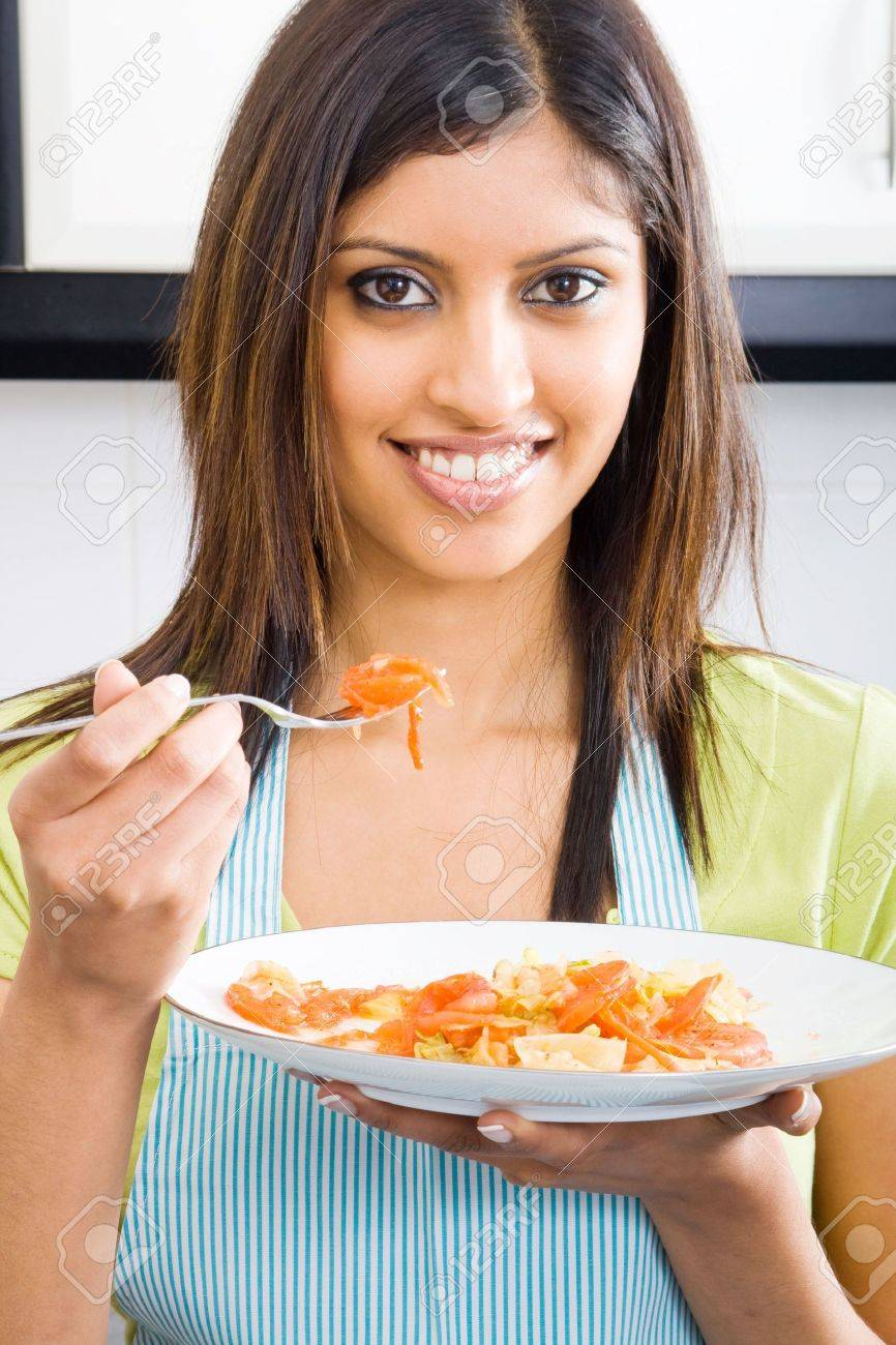young woman tasting food in kitchen Stock Photo - 5493162