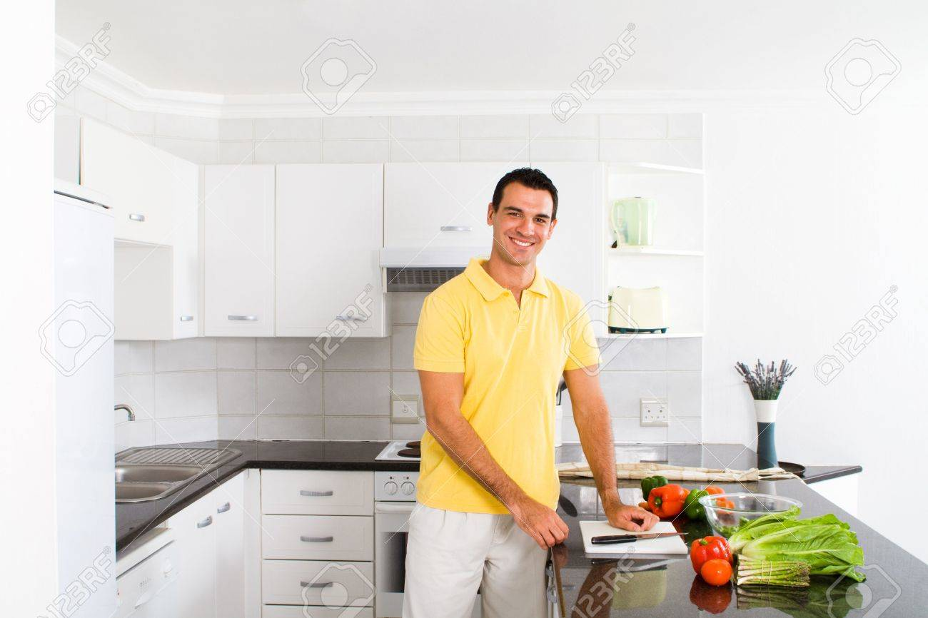happy young man preparing food in kitchen Stock Photo - 6499844