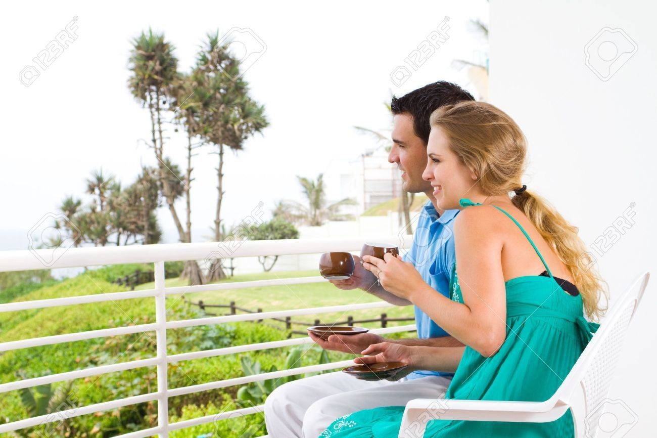 couple drinking coffee on balcony Stock Photo - 6500184