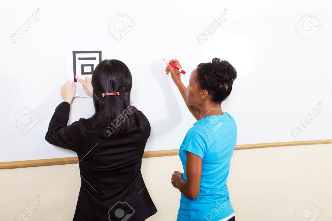 teacher helping student learn chinese writing Stock Photo - 6652075