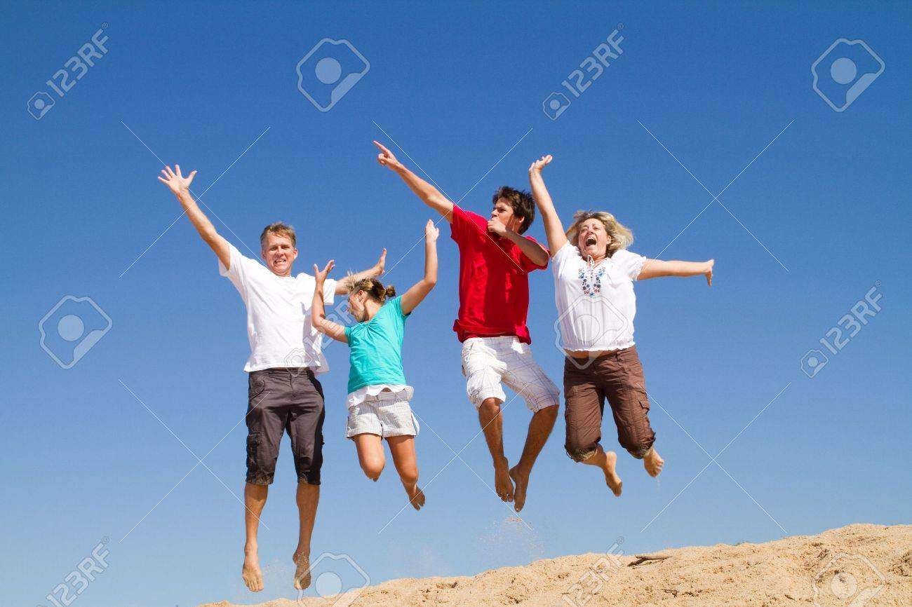 family of four jumping on beach Stock Photo - 6784030