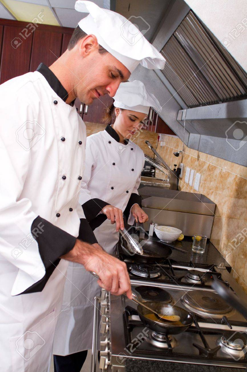 chefs cooking on kitchen stove together Stock Photo - 7326466