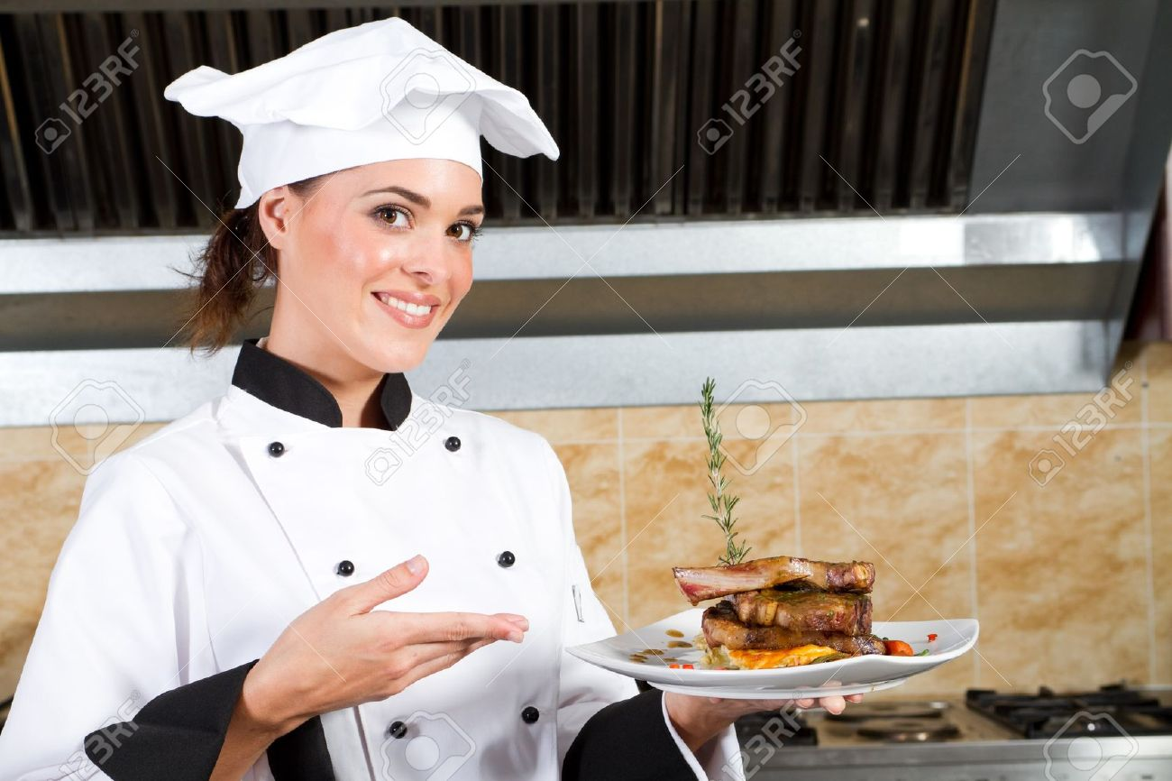 Chef Kitchen Female Chef Presenting Food In Kitchen Stock Photo Picture And