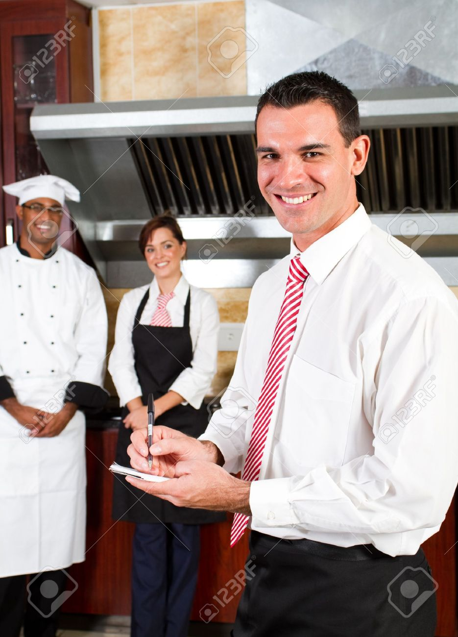 Restaurant Kitchen Staff restaurant kitchen manager happy male and his staff in stock photo