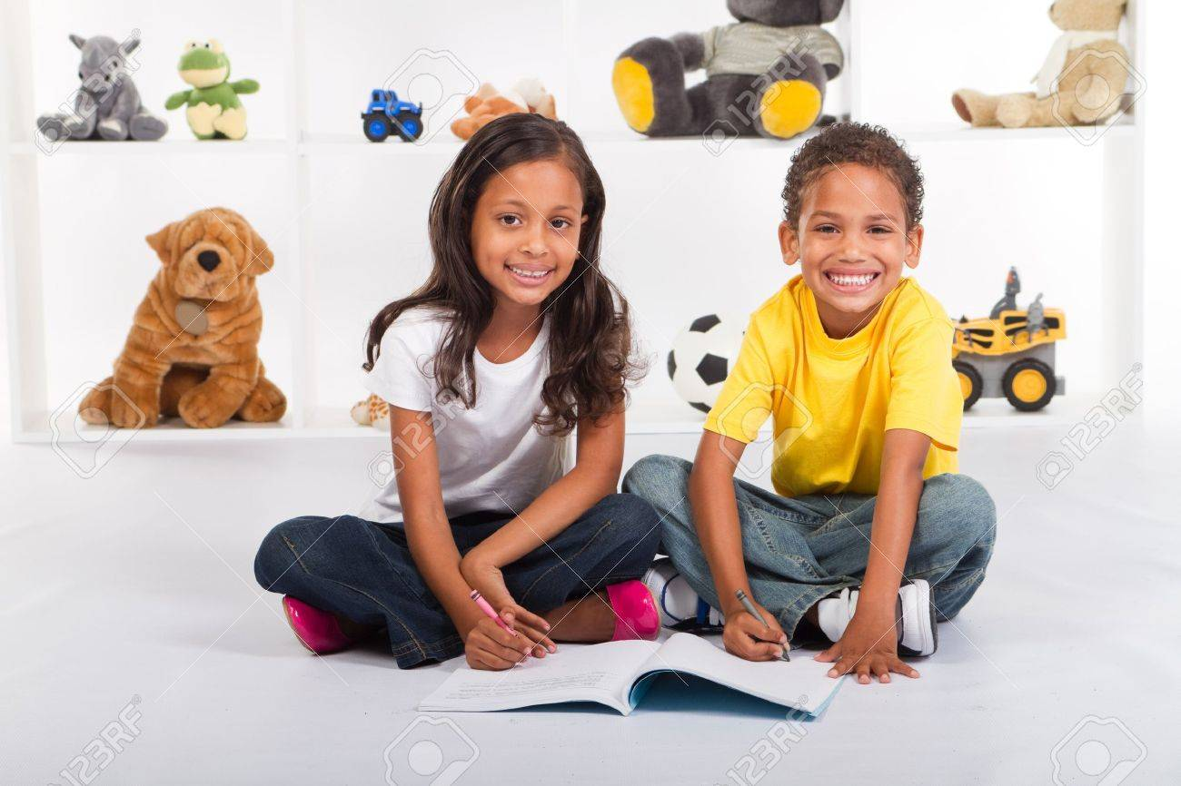 happy african american kids coloring in together Stock Photo - 7592133