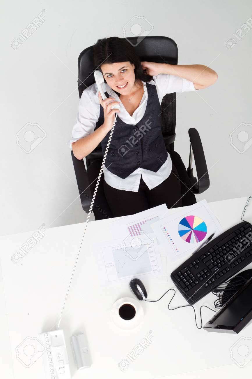 overhead of businesswoman talking on phone Stock Photo - 7642607