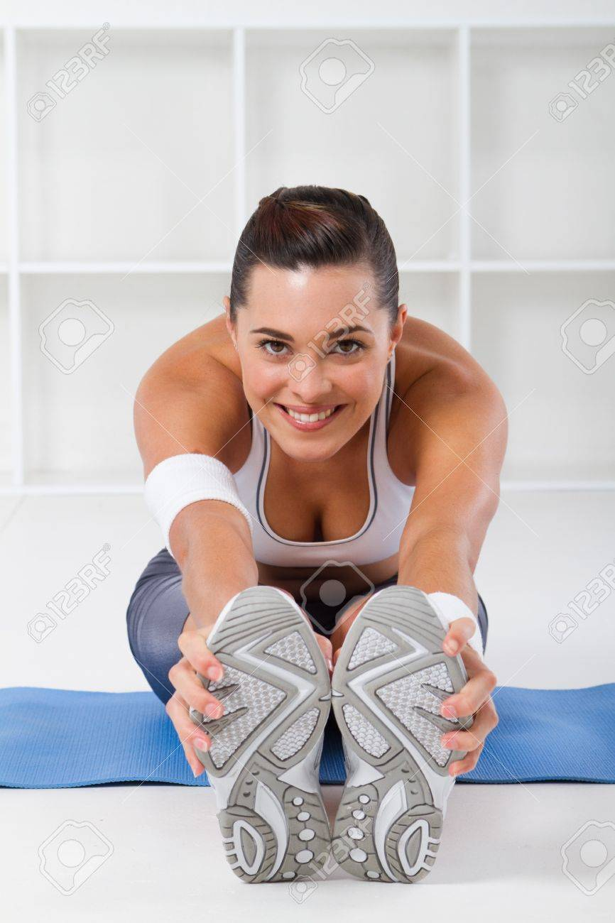 pretty fitness girl stretching indoors Stock Photo - 7639058