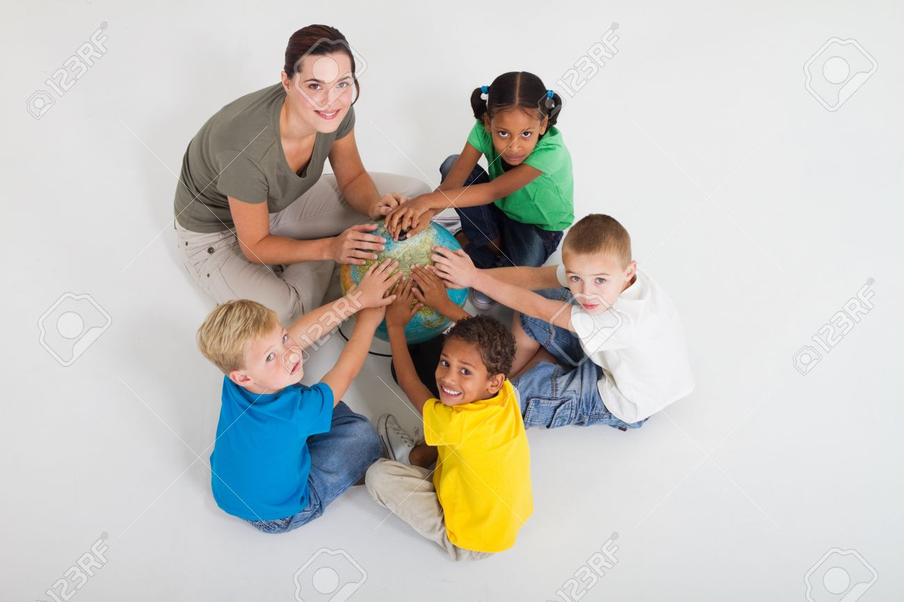 teacher and students hands on globe Stock Photo - 7795755