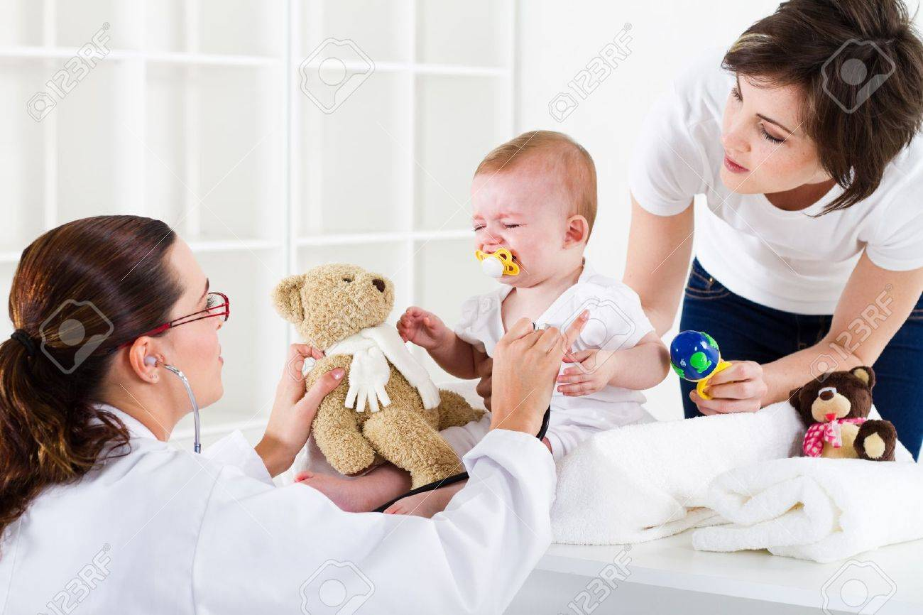 nurse checking crying baby Stock Photo - 7832915