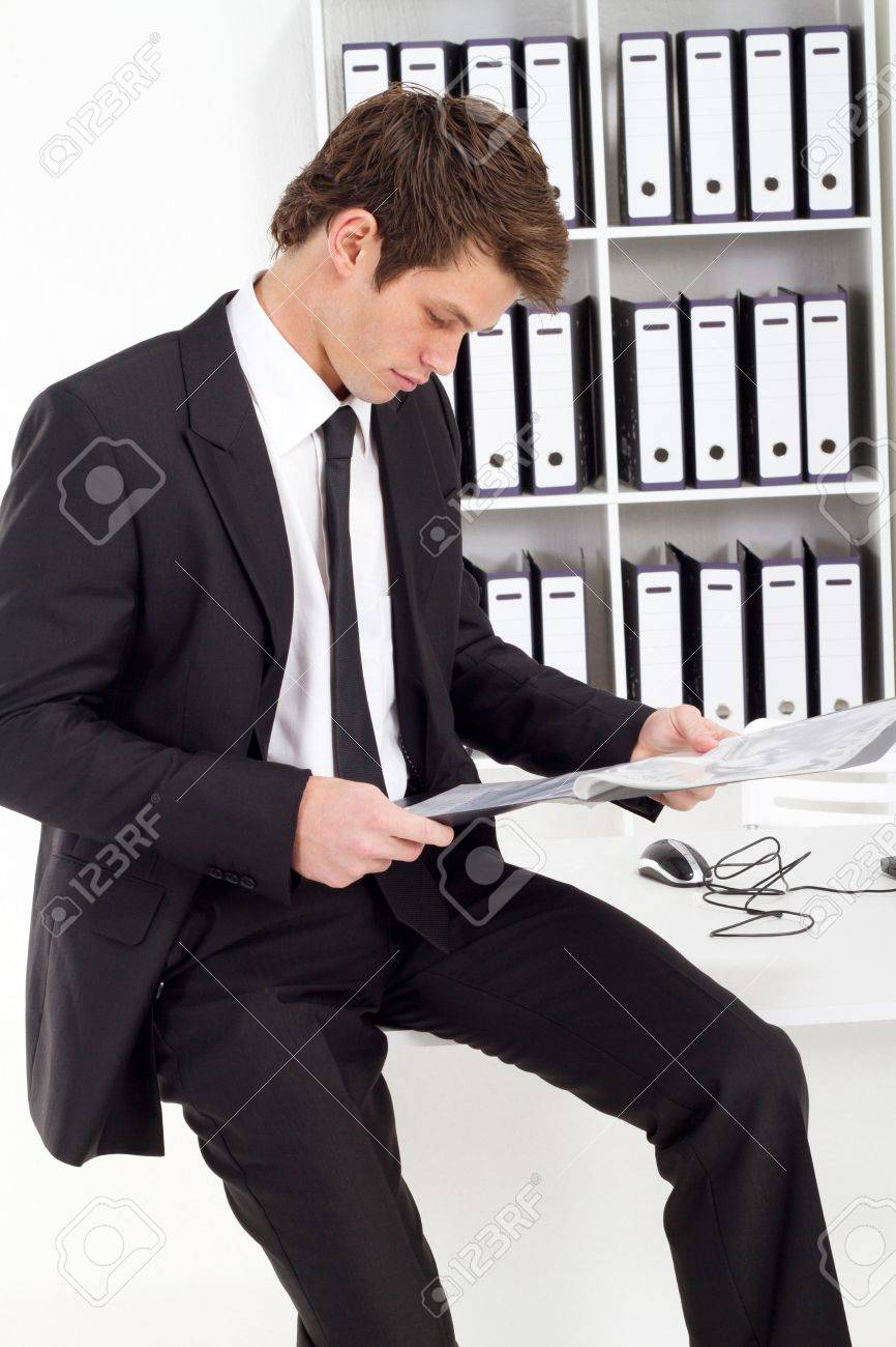 handsome businessman reading documents in office Stock Photo - 7882599