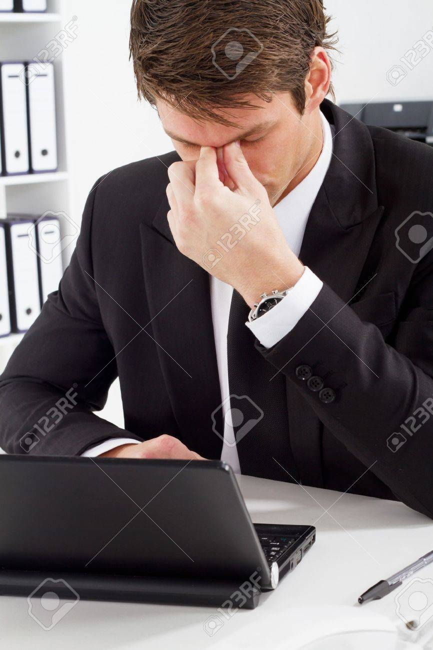 tired businessman in office Stock Photo - 7881984