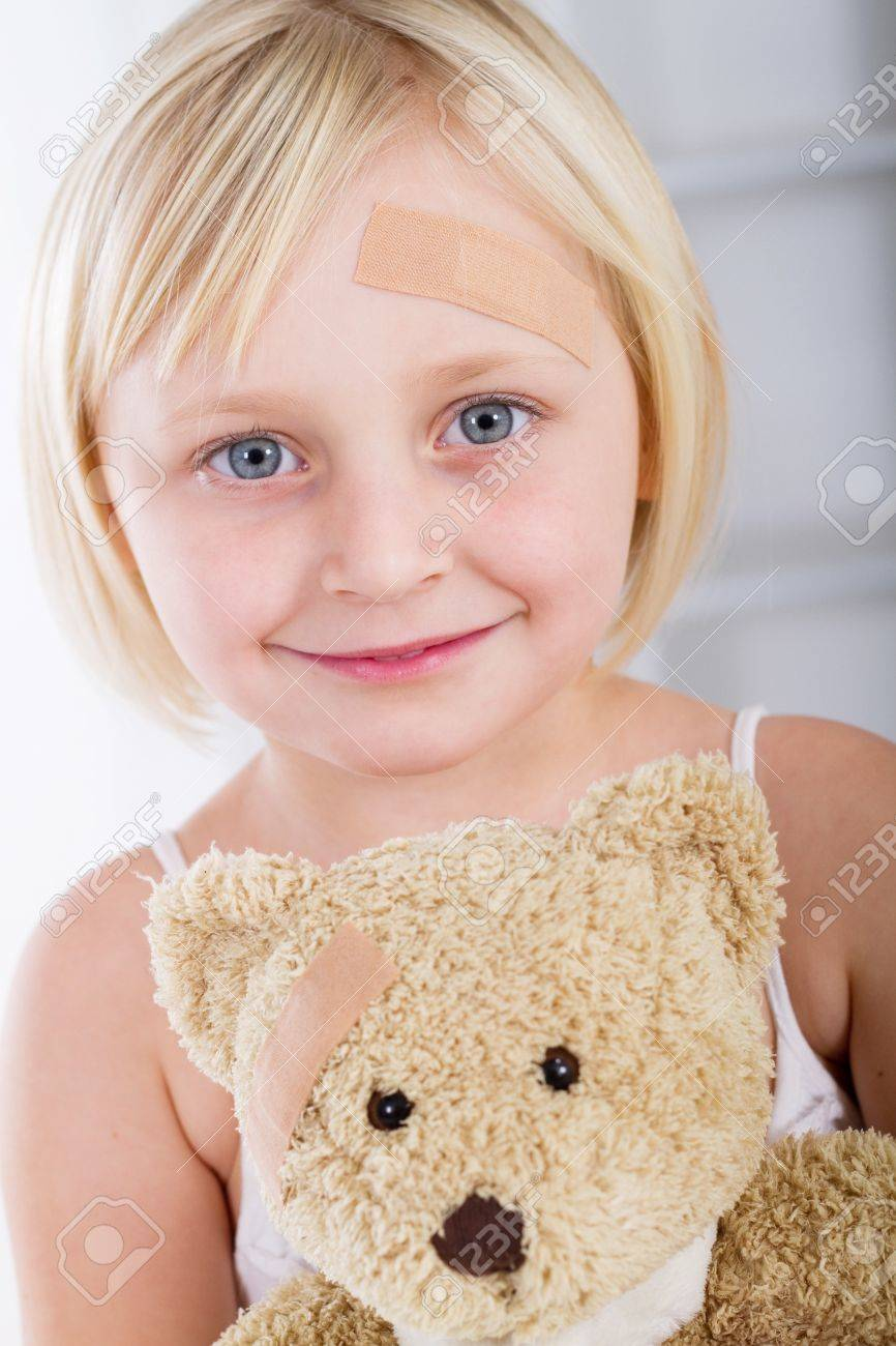 cute little girl with plaster on forehead Stock Photo - 7940110