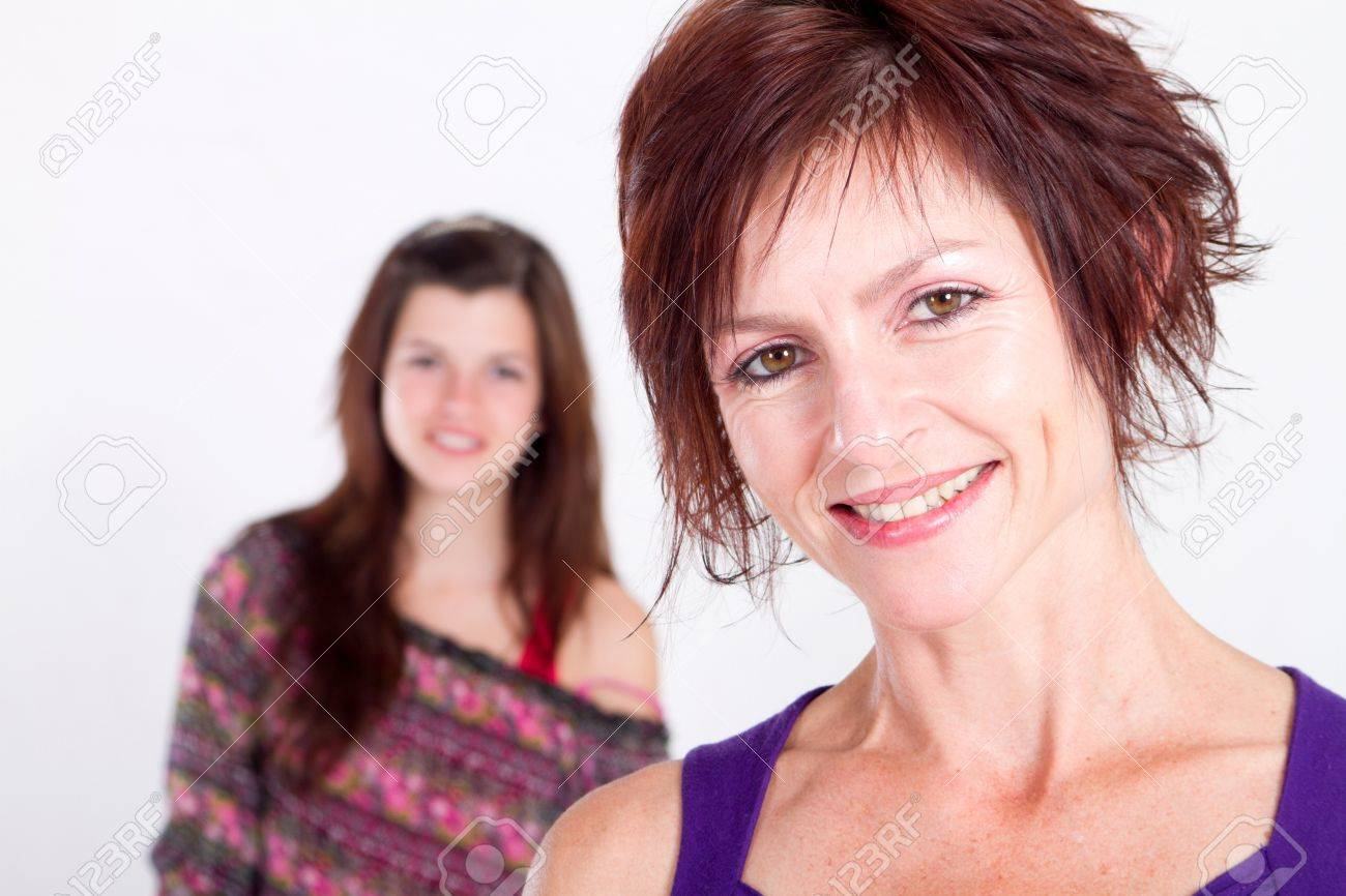single mom with teen daughter in background Stock Photo - 7940106