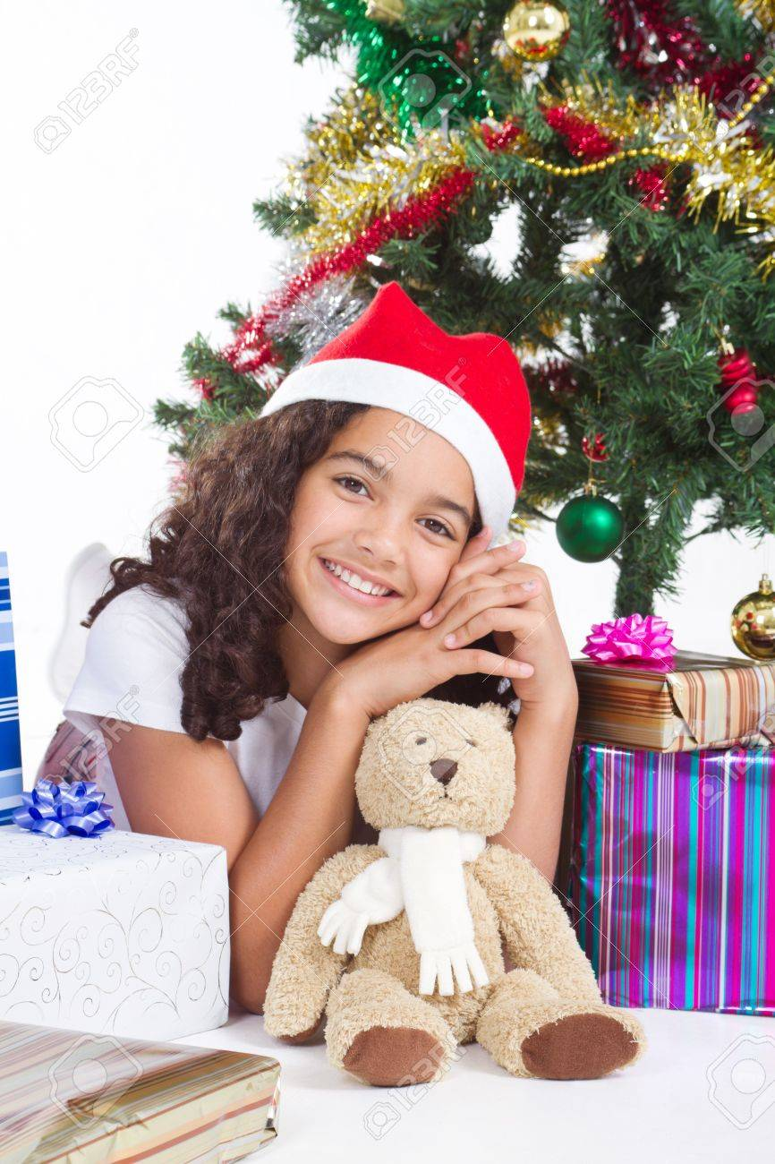 gorgeous young indian girl under christmas tree Stock Photo - 8112122
