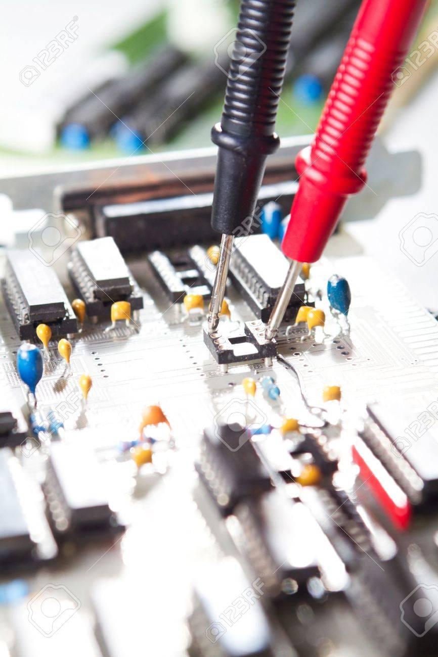 Multimeter examining a circuit board Stock Photo - 9091749
