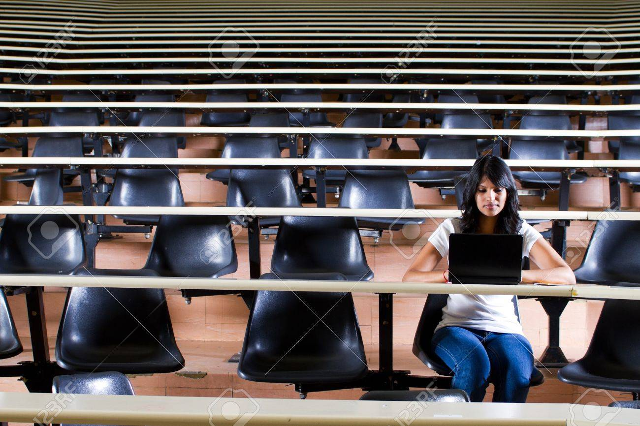 female college student alone in university lecture hall Stock Photo - 9843976