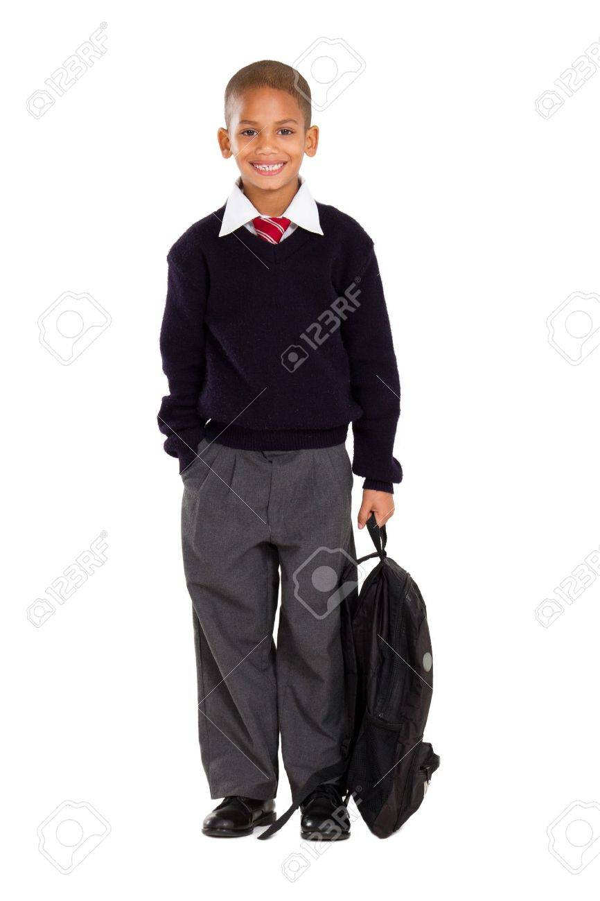 full length studio portrait of male elementary pupil on white Stock Photo - 10739938