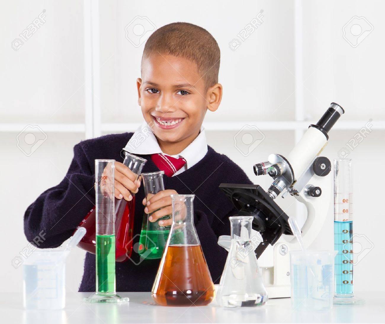 happy primary schoolboy in science lab Stock Photo - 10746675