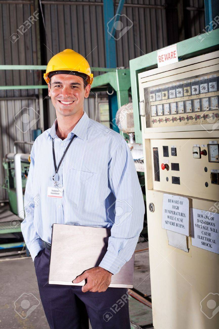 happy male industrial technician inside a factory Stock Photo - 12431509