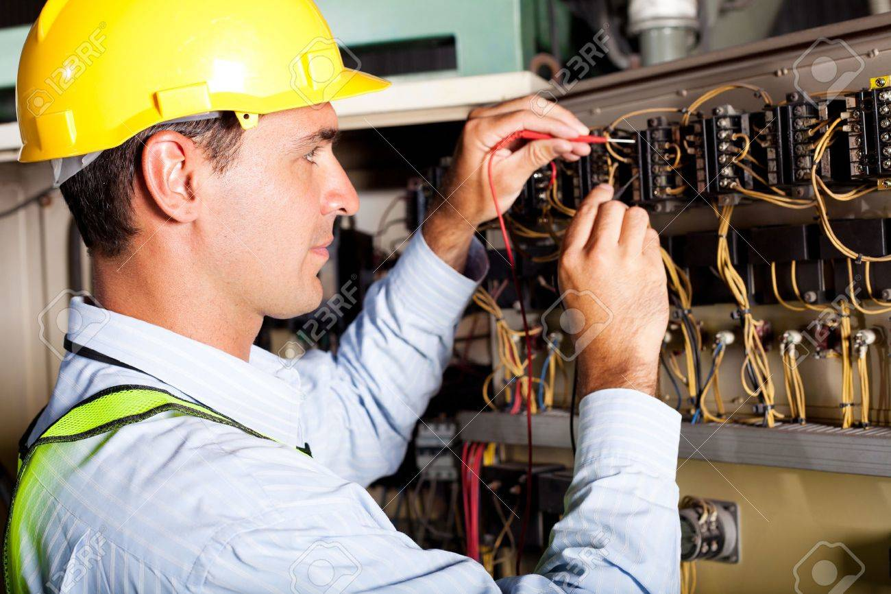 Male Electrician Testing Industrial Machine Stock Photo, Picture ...