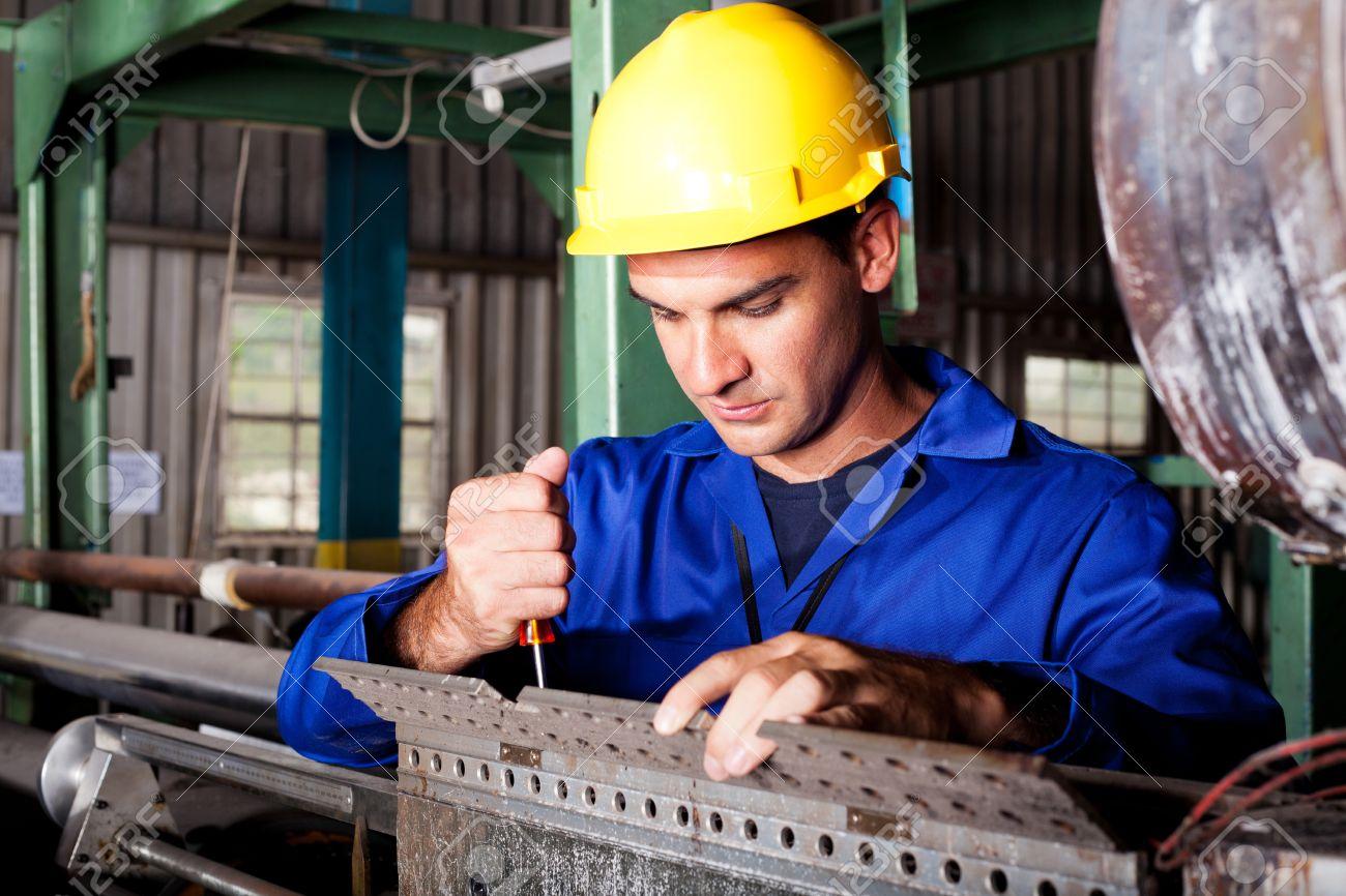 Industrial Mechanic Repairing Heavy Industry Machine Stock Photo ...